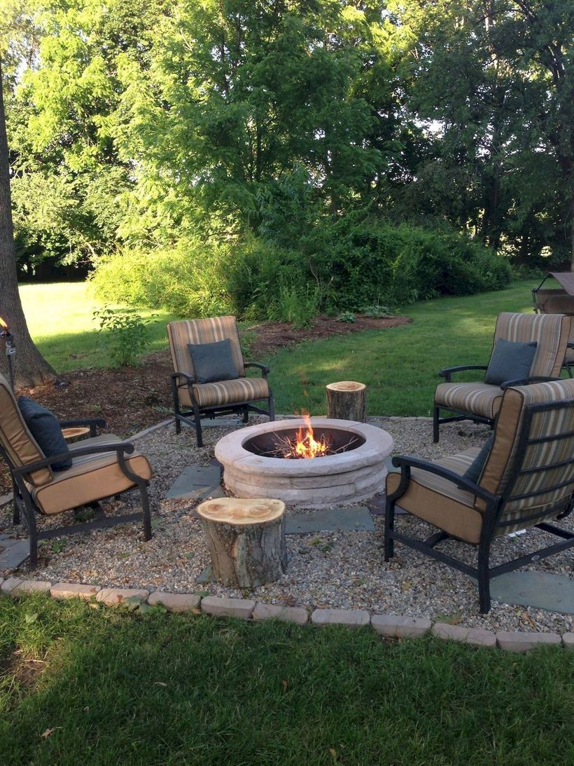 Round fire pit with rustic chair