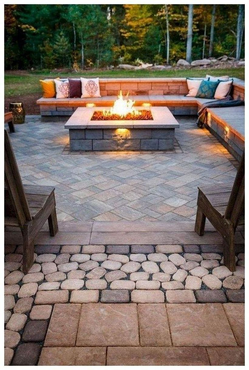 Stunning stone fire pit with l-shaped chair