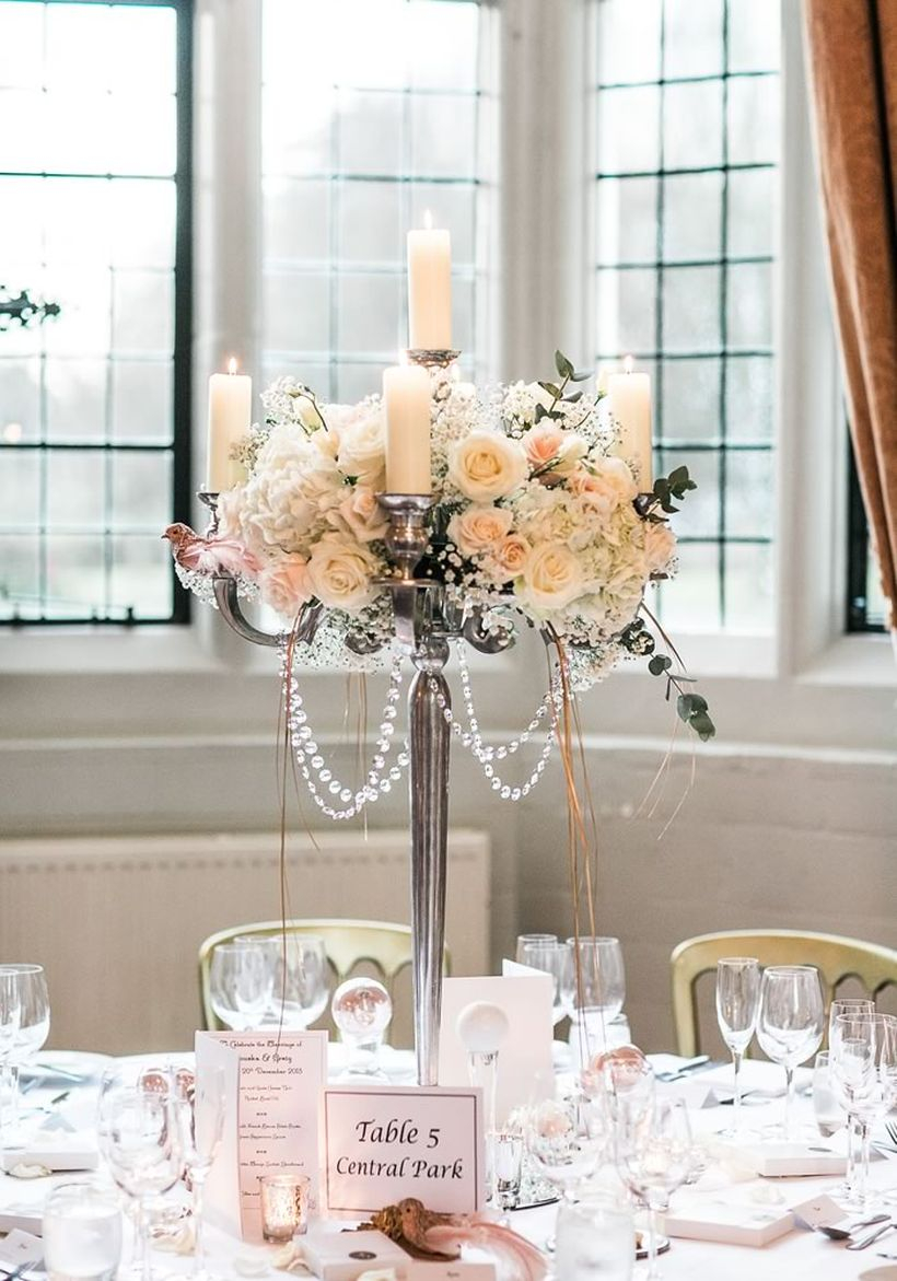 Wedding decoration silver candelabra to create tables to complement their venue's existing style with elegant roses and garlands of crysrtal beads