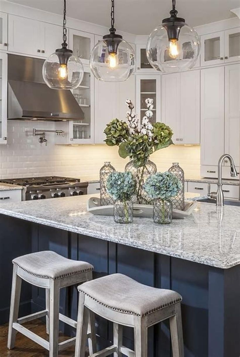 White countertop design with square white wooden chairs