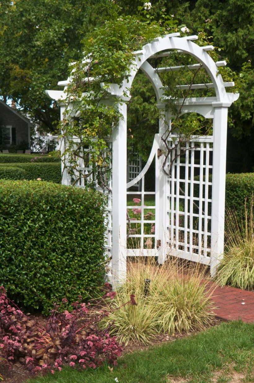 White curved wooden trellis for the gate
