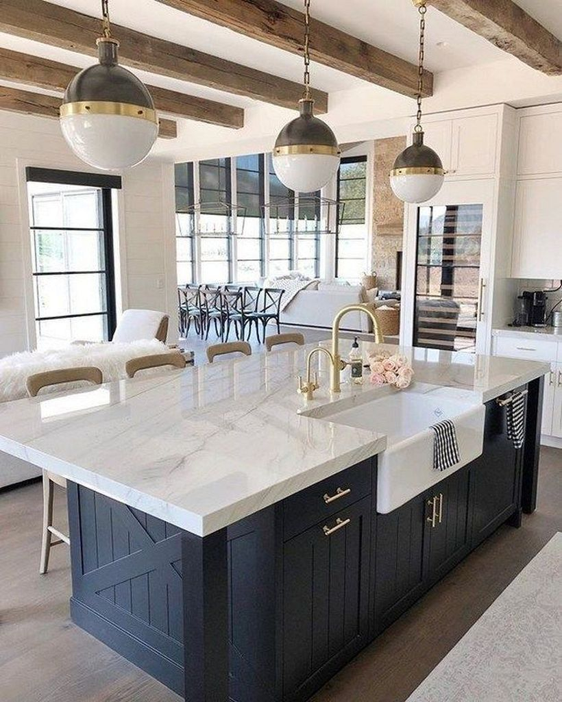 White marble countertop design on blue wooden cabinet