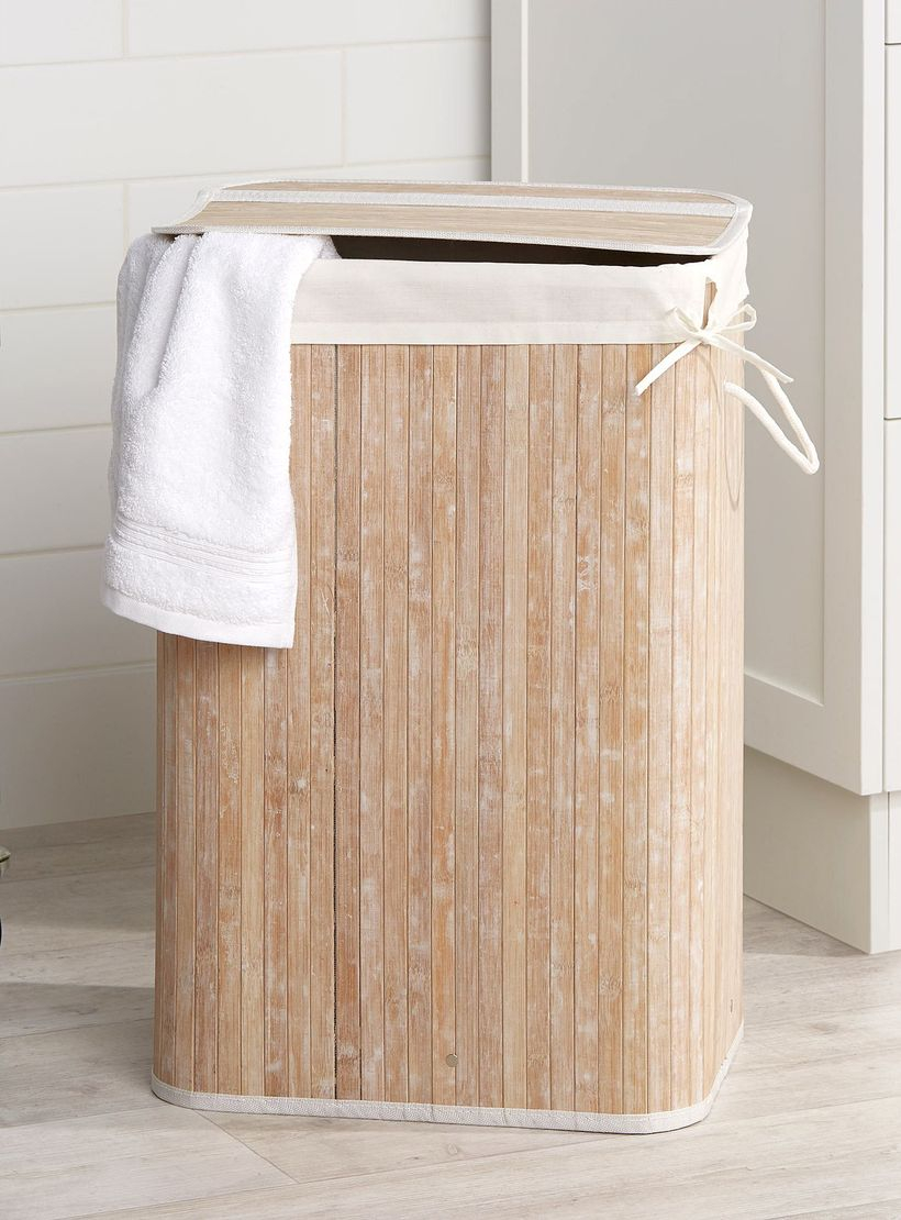 Wooden basket to store dirty clothes