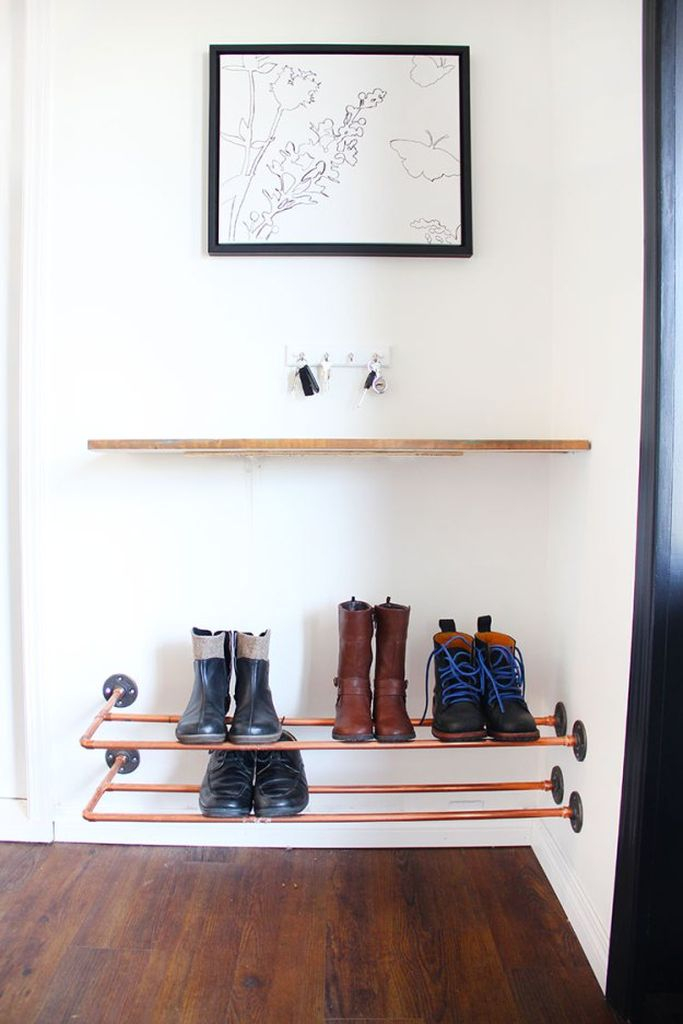 A creative shoes storage idea for a small bedroom with floating shelves with iron materials to organize your shoes storage