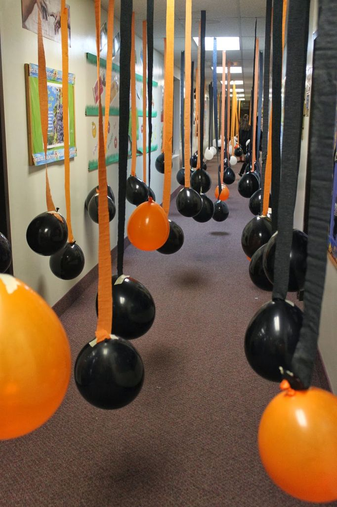 An awesome indoor decorations for halloween with hanging balloons from the ceiling to perfect your decoration