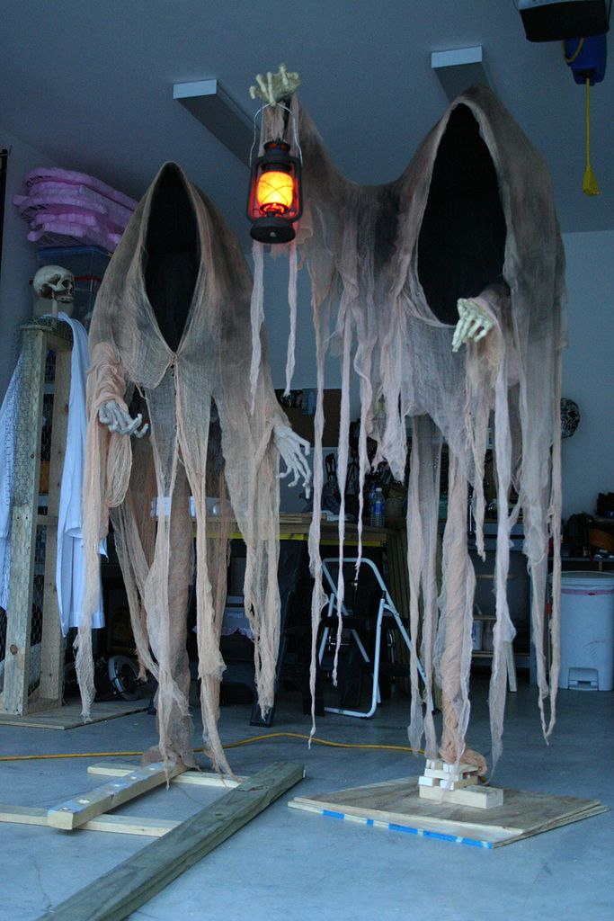 An awesome outdoor decorating for halloween with haunting hooded ghouls to complete your garden decoration