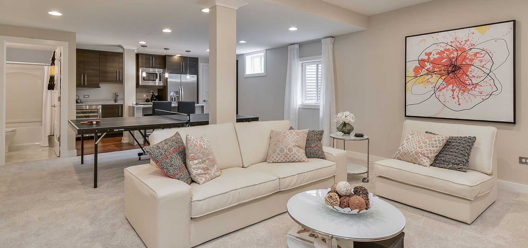 Basement with white latter l sofa and bar decoration