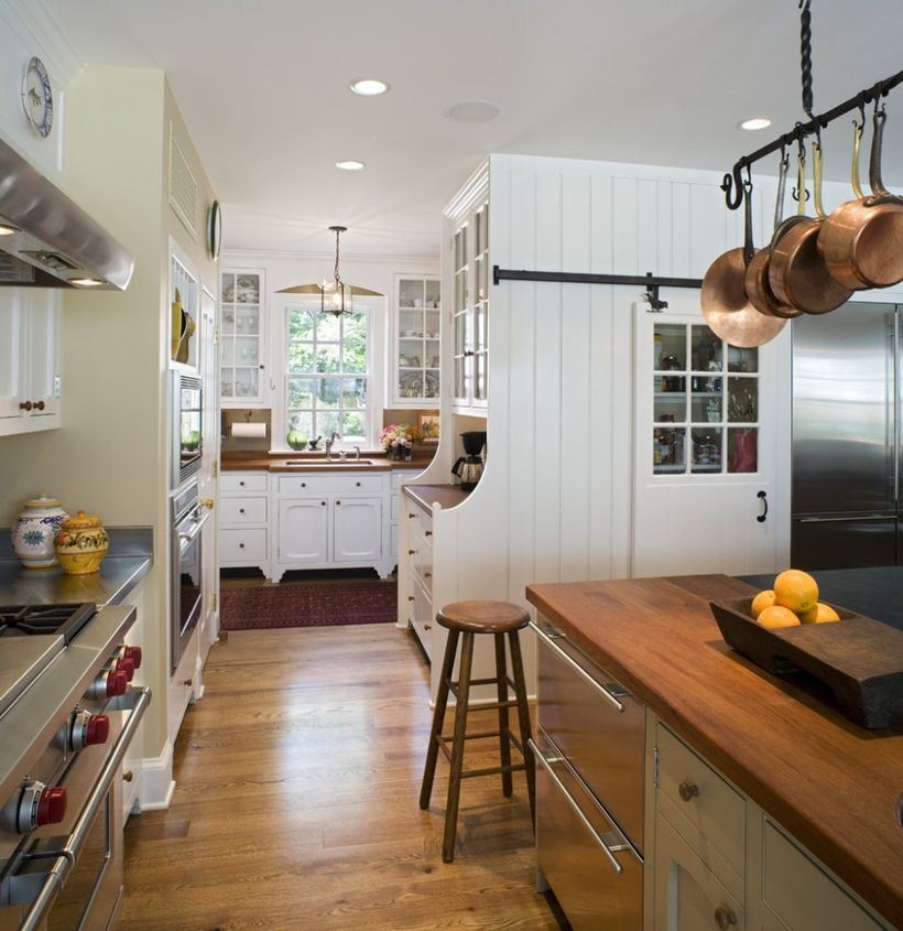 Best wooden kitchen flooring with white cabinet, wooden island table and small wooden chair