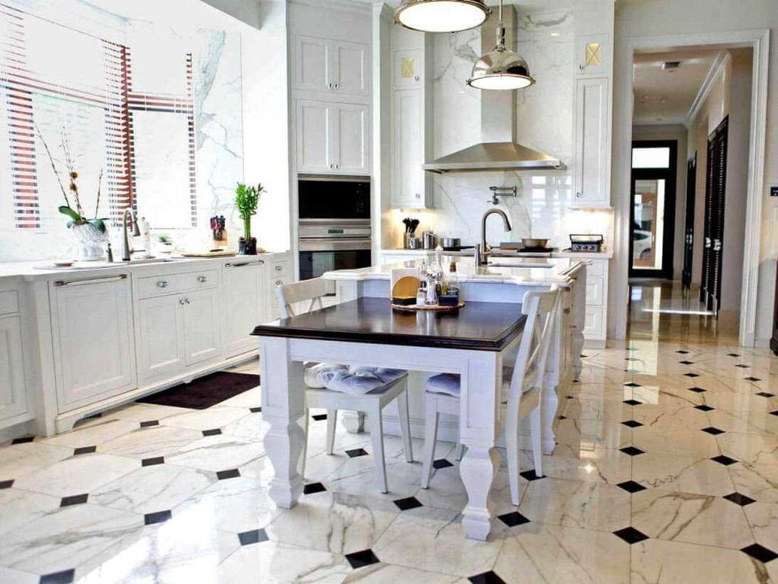 Black and white patterned kitchen floor with white wood cabinet and white wood island table ideas