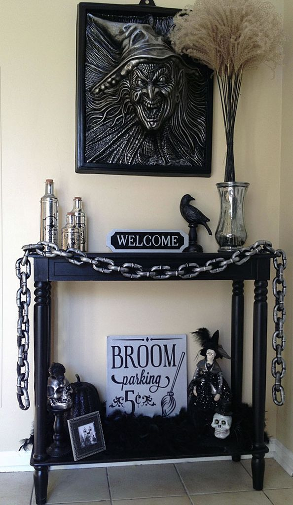 Captivating creepy indoor decorations with wall decoration above black table to perfect your halloween decoration