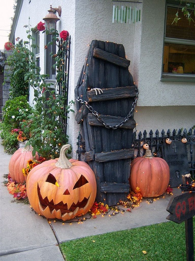 Captivating outdoor decorating for halloween with cryptic coffin combined with scary pumpkins to complete your outdoor decoration