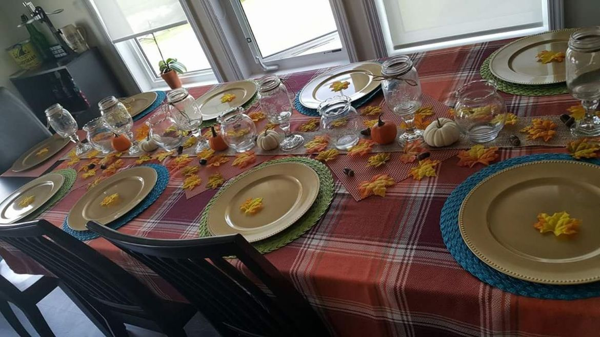 Checked-table-cloth-with-minimal-decoration-for-thanksgiving-dining.-
