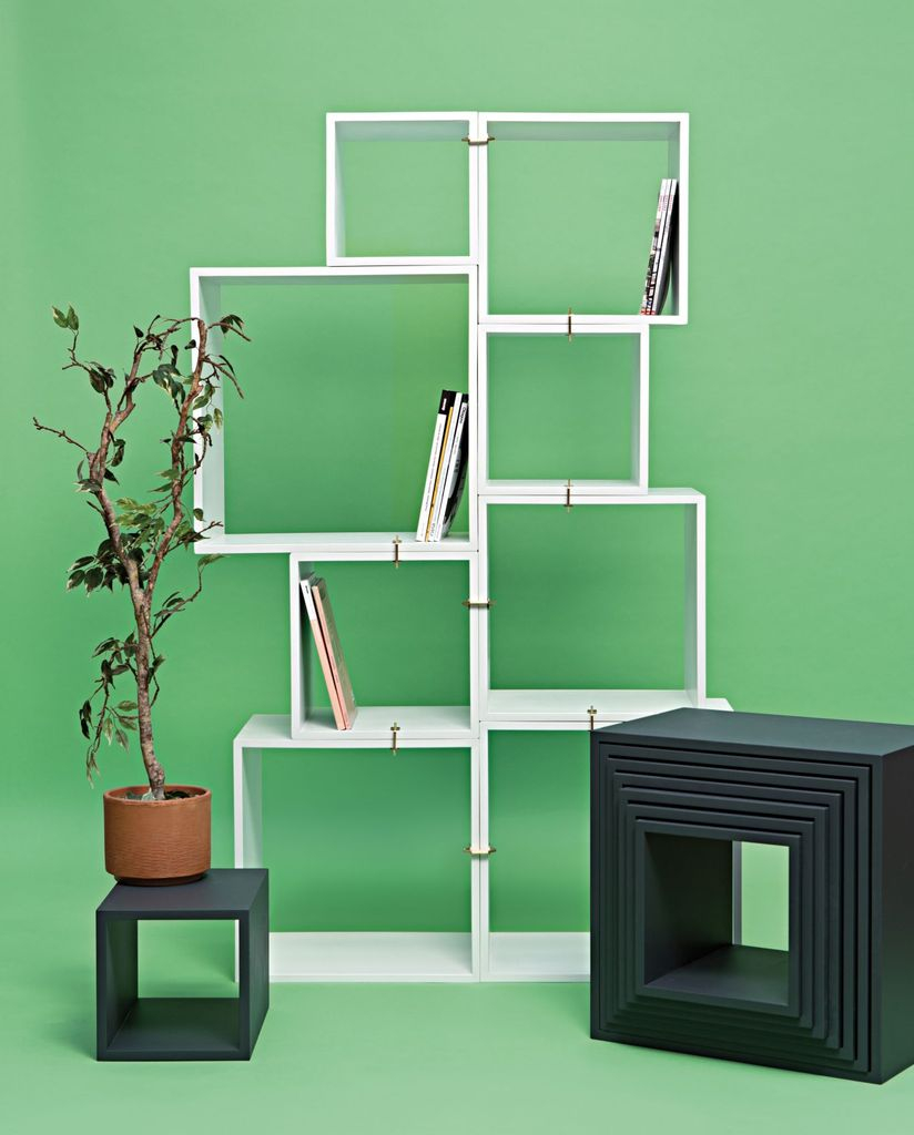 Contemporary book storage ideas for a small bedroom with cube storage in white to organize your book in the small bedroom