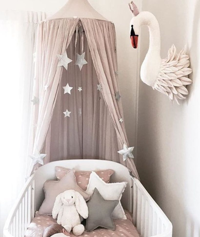 Cute-baby-girls-nursery-room-with-goose-accents-for-wall-decorations-and-star-shaped-pillows-so-baby-is-comfortable-while-sleeping