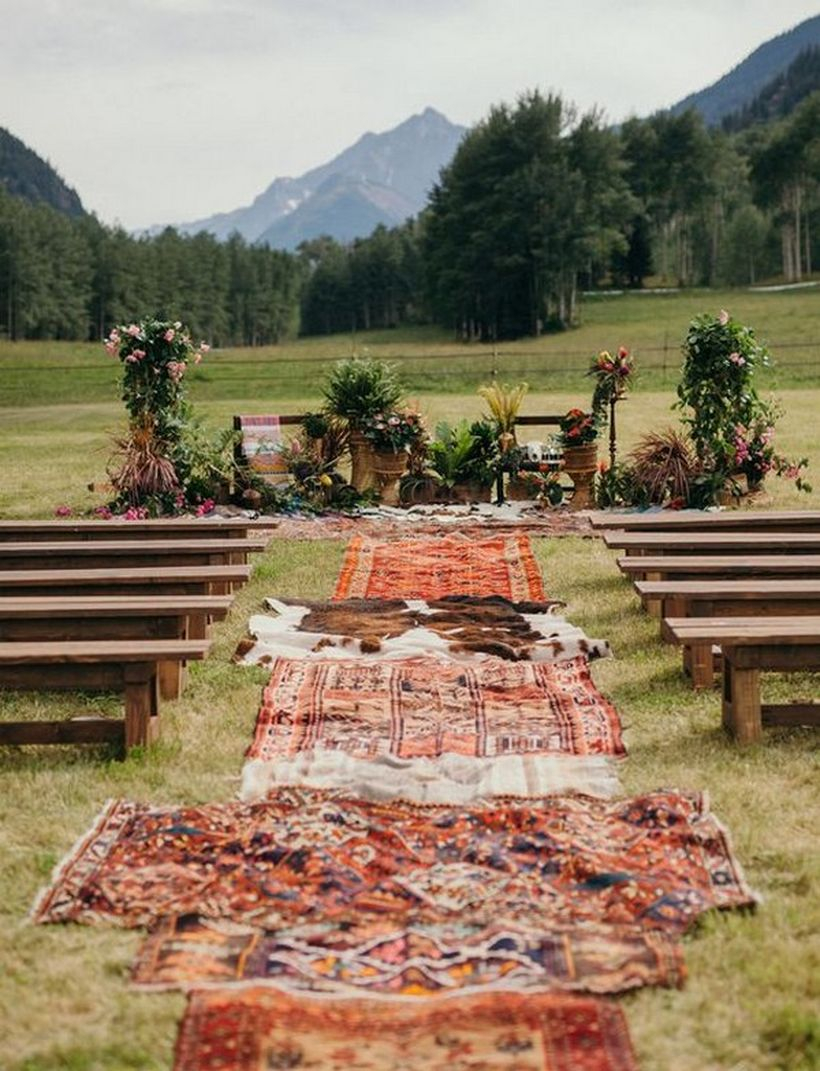 Diy outdoor boho wedding ceremony with wooden chirs and carpet