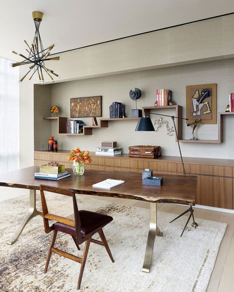 Grey walls combined with wooden shelves to perfect your home office