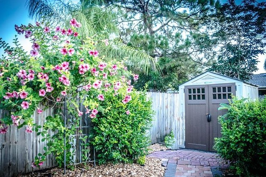Natural shed design with flower on the front