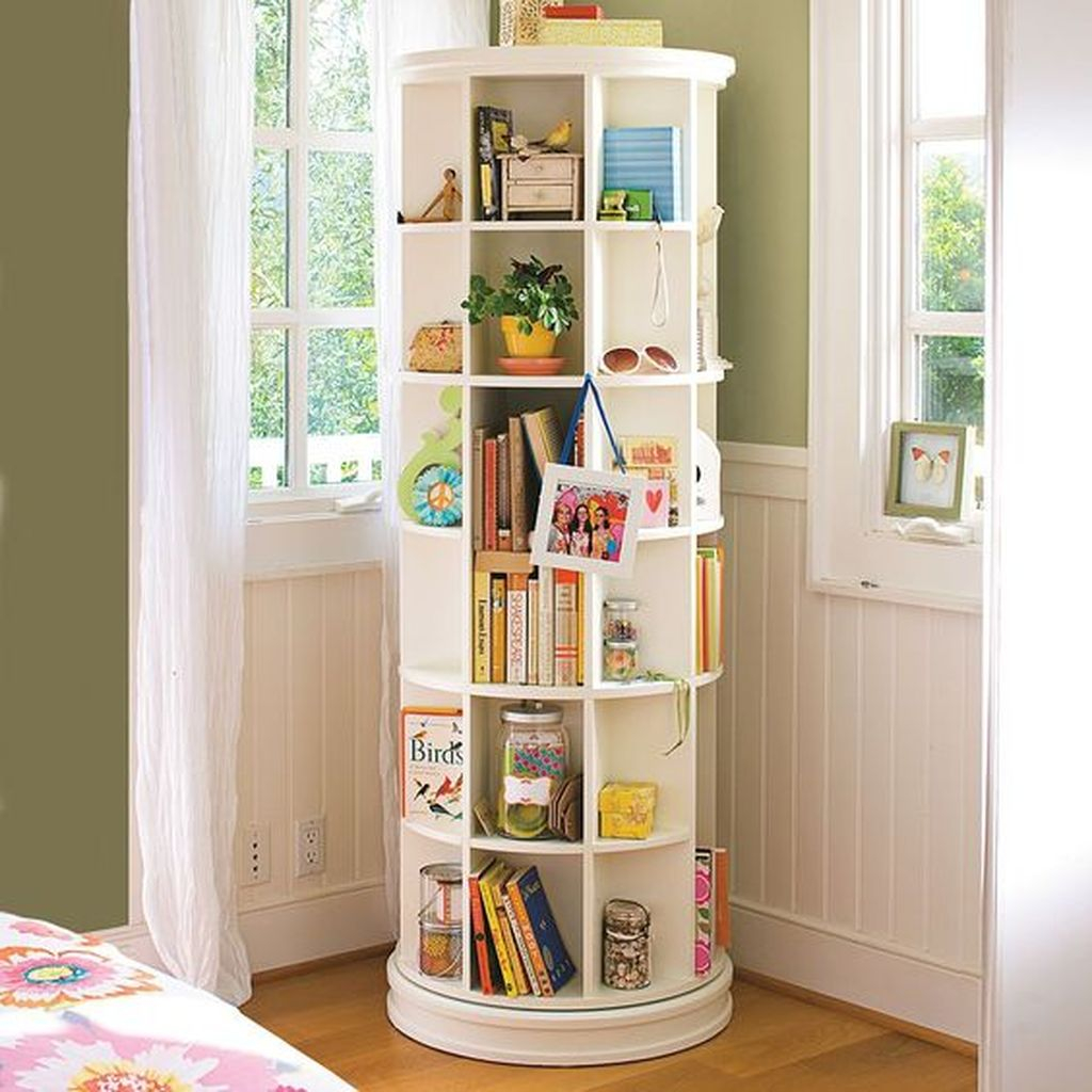 Perfect small bedroom ideas with revolving bookshelf at the corner to beautify your bedroom design
