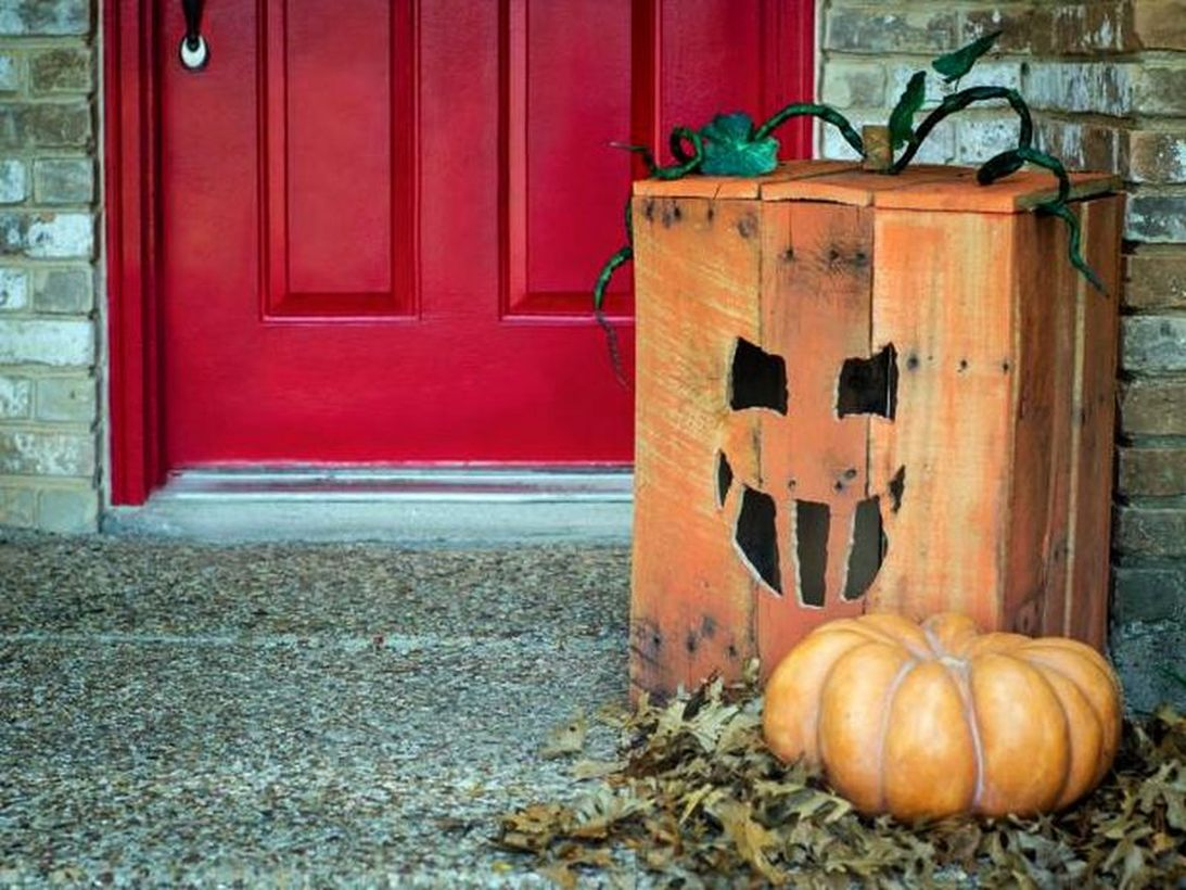 Square orange halloween lanterns from wooden pallets for home decoration