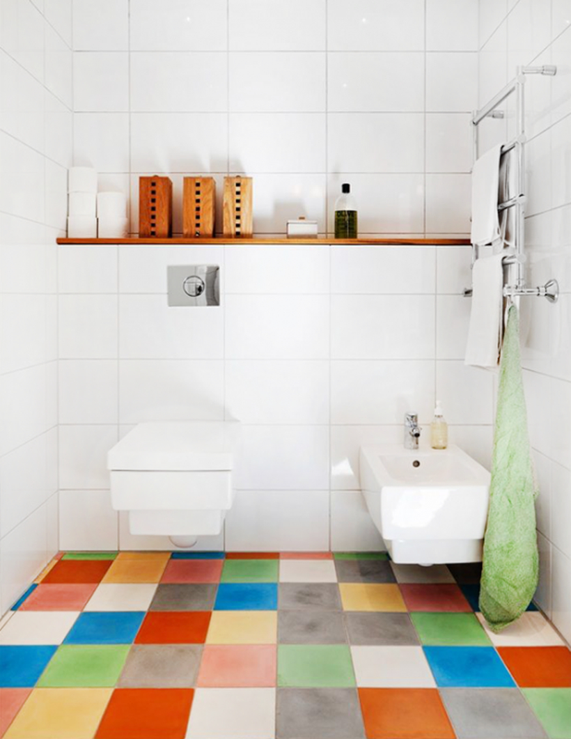 Stunning bathroom with colorful tile, white closet and sink for simple decoration