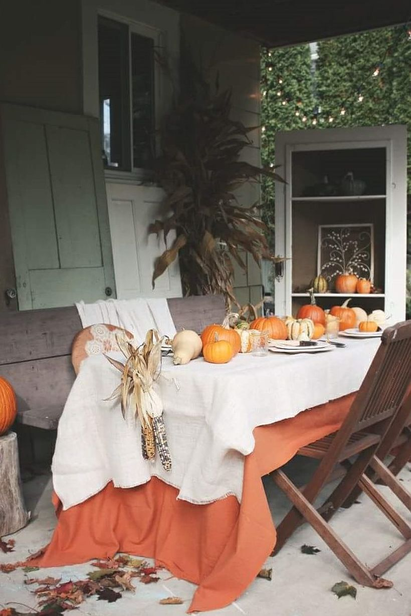 Thanksgiving-decoration-with-pumpkin-and-table-cloth.-