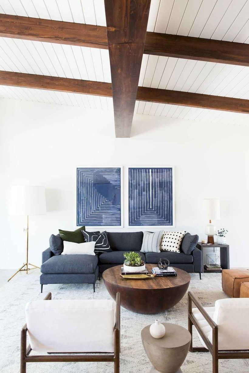 White living room combine white dark gray letter l sofa, round wooden table, white wooden sofa chairs to look confertable