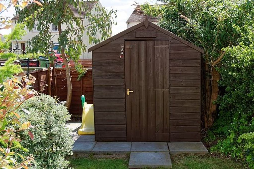 Wooden shed on beside toy
