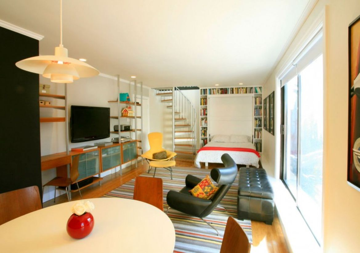 Basement white bedroom, black soffa and round table