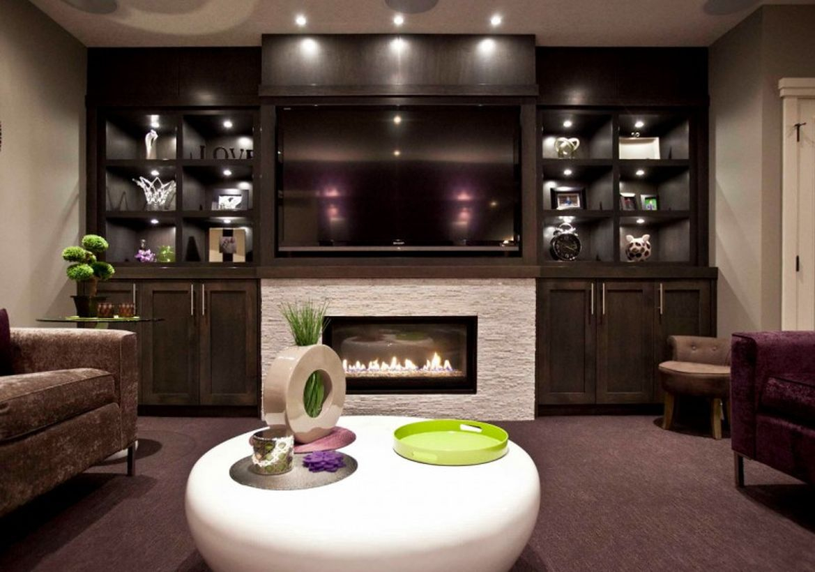 Basement with a living room combined with a white fireplace
