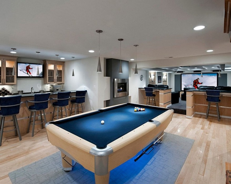 Basement with blue billiard place and modern bar
