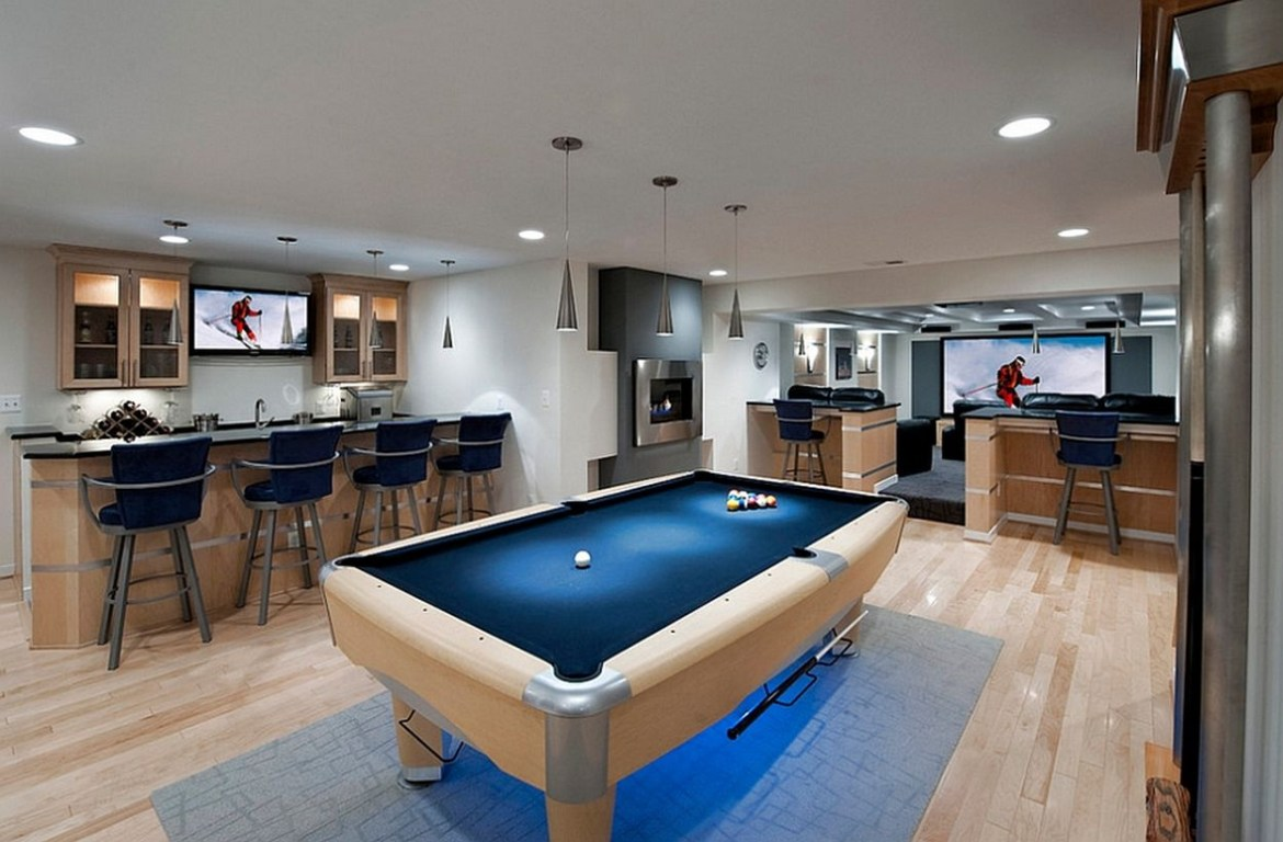Basement with blue billiard place and modern bar