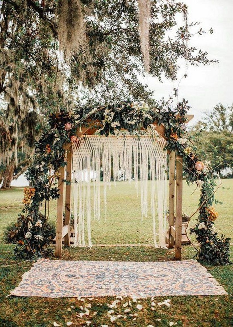 Boho wedding decorations with white knit fabric, flower decoration and green plants