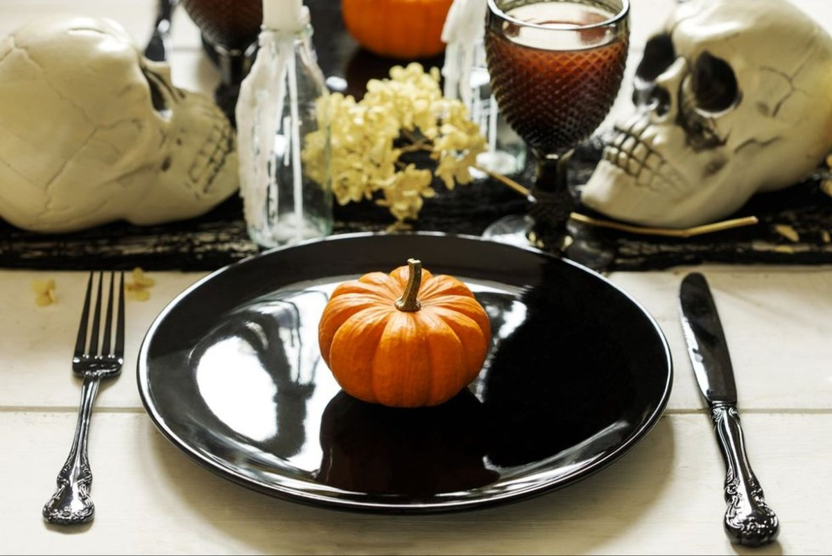 Halloween table decoration with skulls and pumpkin