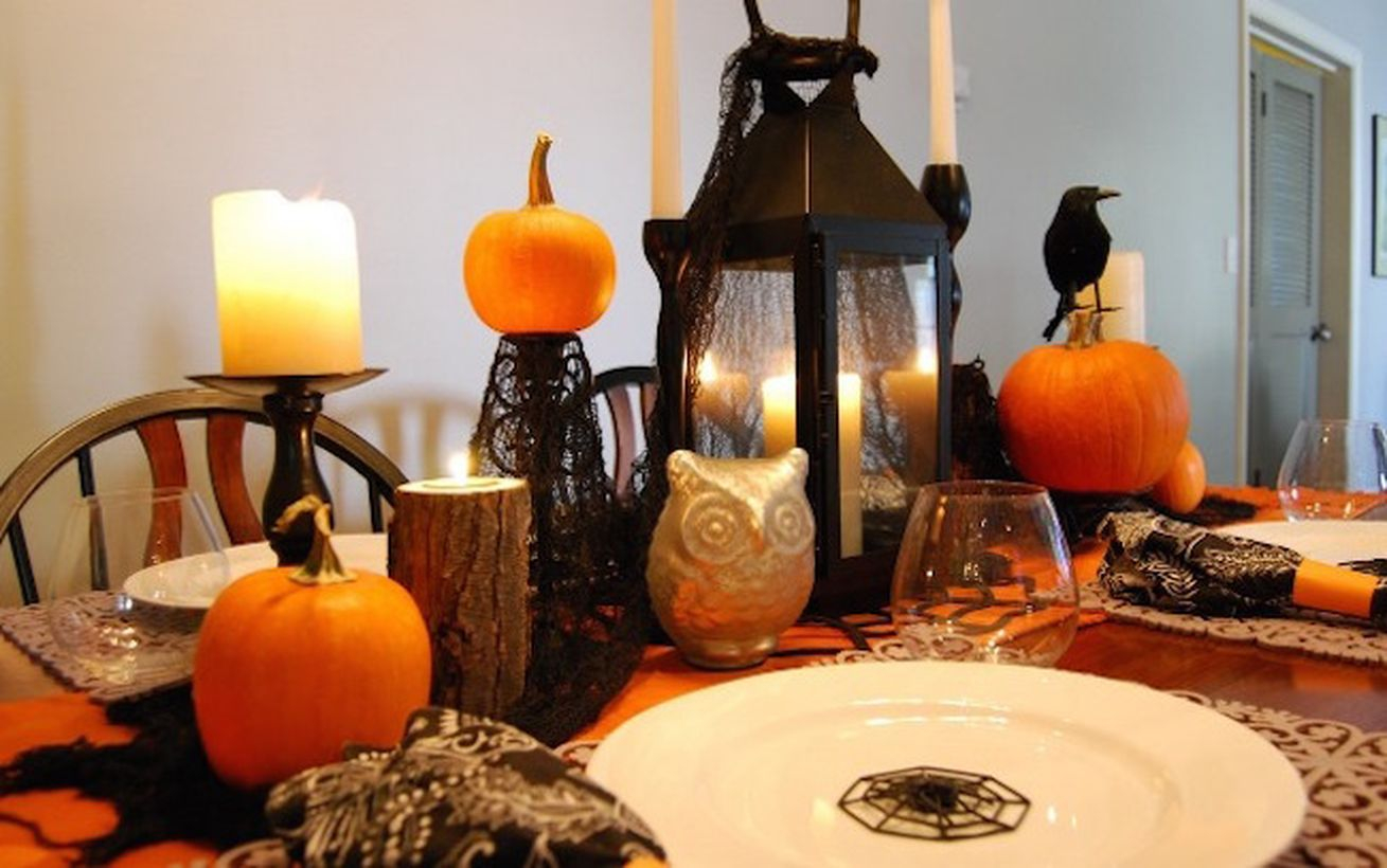 Lantern candle holder and arrangement pumpkins for dinner setting