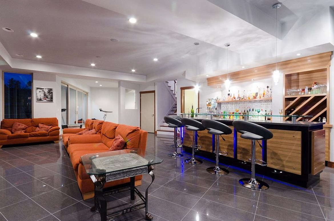 Modern basement with bar and living room