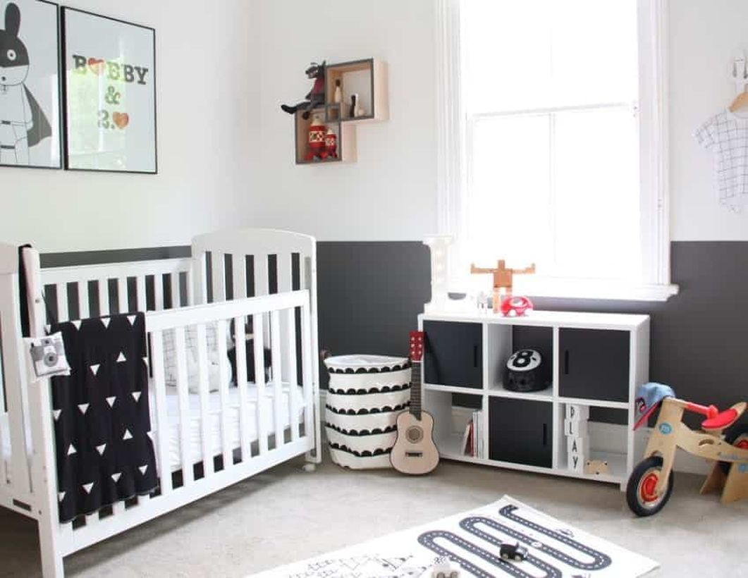 Monochrome-baby-boys-nursery-room-with-white-wooden-bed-baby-and-wooden-storage-to-store-various-ornaments