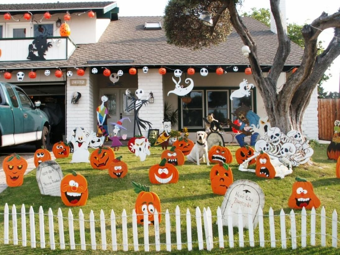 Scary pumpkin and ghost arrangement on front yard
