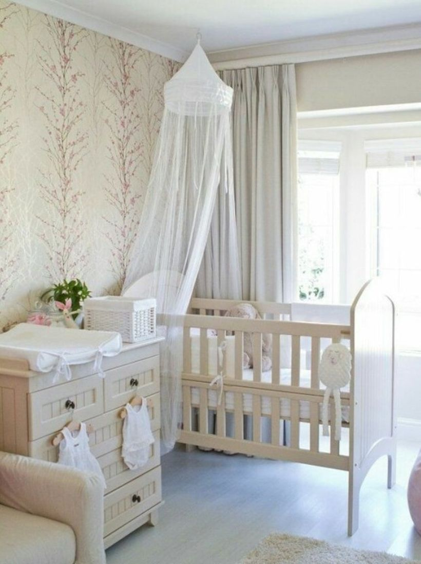 Simple-and-neat-baby-girls-nursery-room-with-wooden-white-bed-and-storage-baby-mosquito-nets-to-protect-your-baby-while-sleeping
