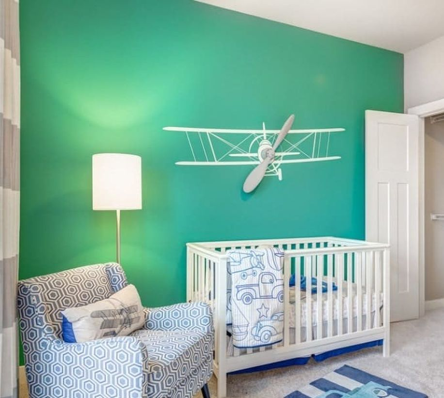 Simple-nursery-for-baby-boys-with-miniature-airplane-for-decoration-wall-and-floor-lamp-to-decorative-lighting