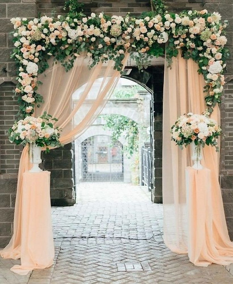 Wedding entrance decorations with white curtain and floral decoration