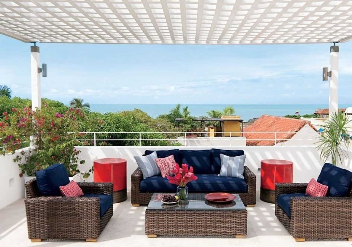 A-shaded-rooftop-with-dark-rattan-chairs-and-soft-foam-to-make-it-more-comfortable-when-sitting