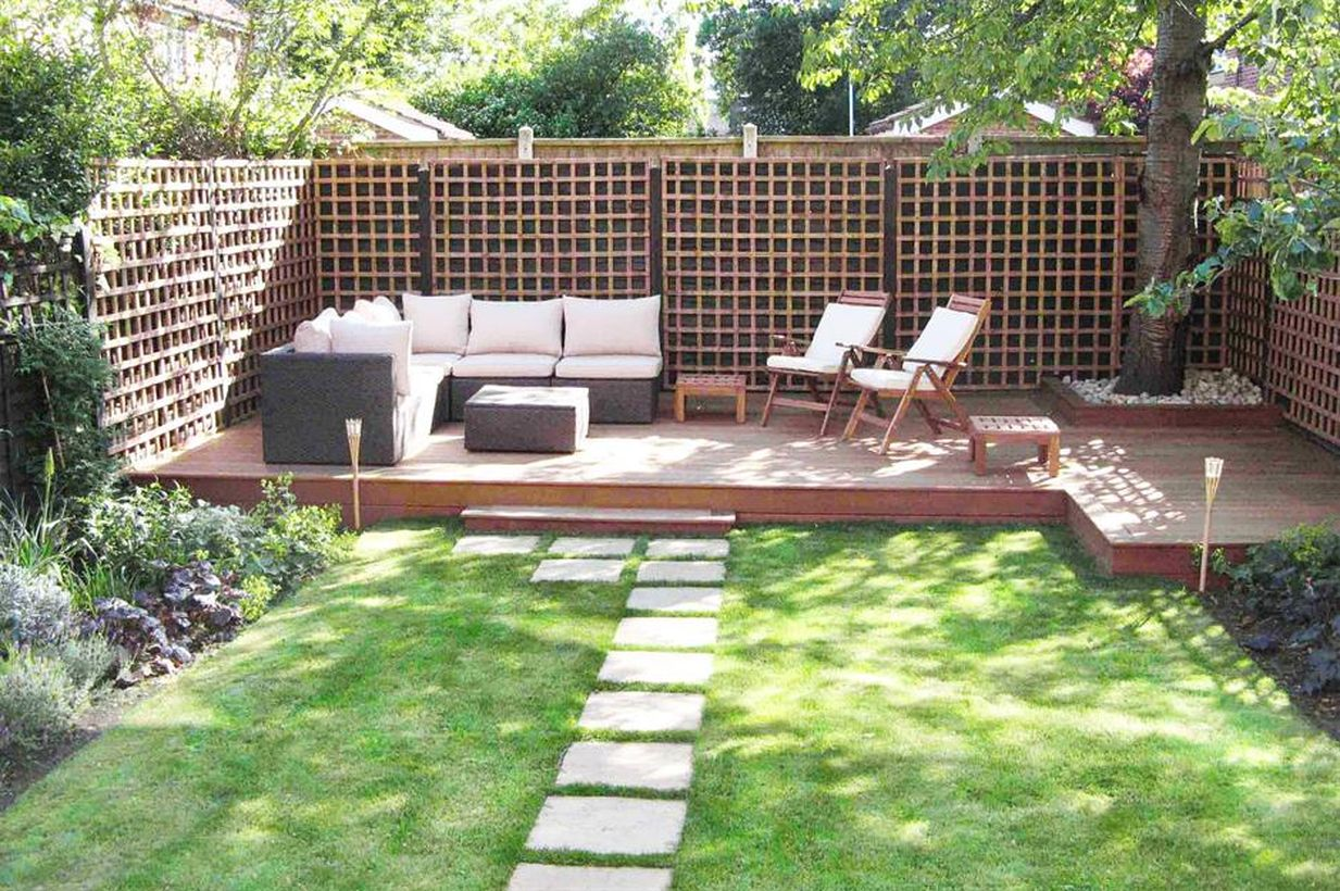 A-cool-backyard-patio-deck-design-is-added-with-greenery-adorning-your-backyard
