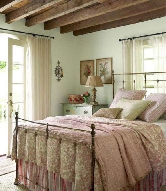 Mint-walls-wooden-beams-on-the-ceiling-and-floral-print-bedding.-1