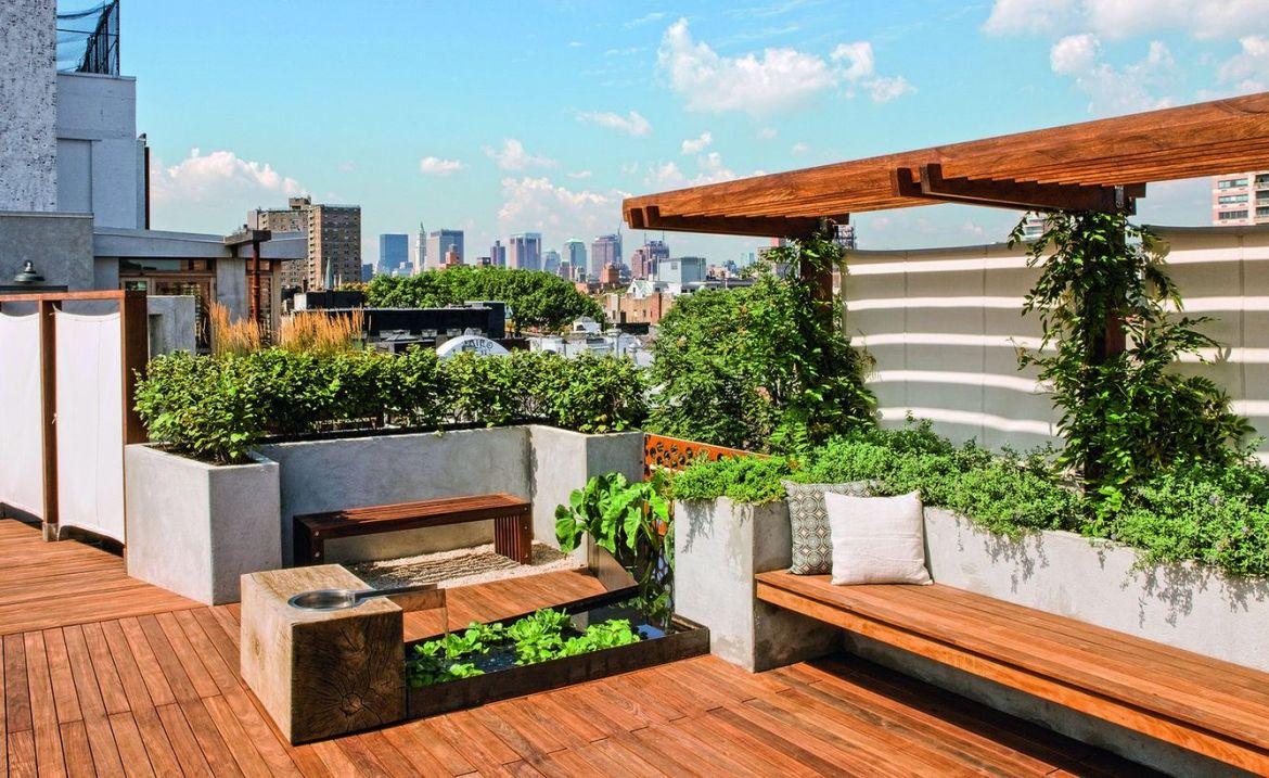 Rooftop-designs-with-greenery-which-is-like-a-garden-and-wooden-loung-chair-to-enjoy-a-green-and-fresh-atmosphere