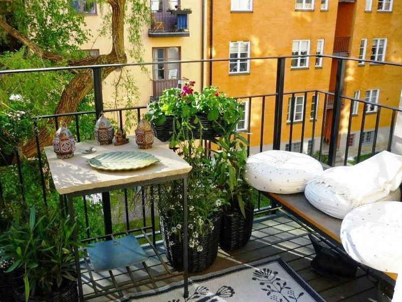 Unique-balcony-garden-with-herb-and-corner-home-lawn-elegant-interesting-classic-bench-and-a-small-table.