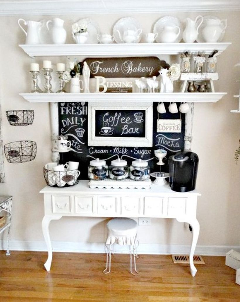 White coffee bar combined with a black board, unique white shelves and a small white chair