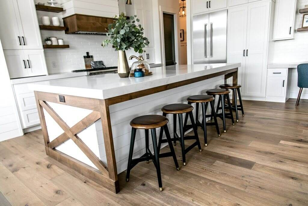 Wooden floor combined with white cabinets