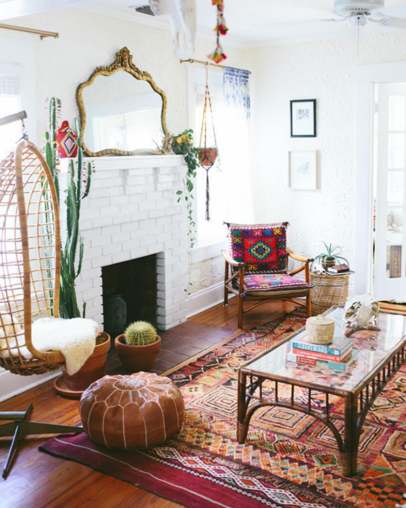 A-unique-living-room-a-boho-theme-looks-great-combined-with-colorful-boho-patterns-on-rugs-chairs-and-coffee-table-rattan