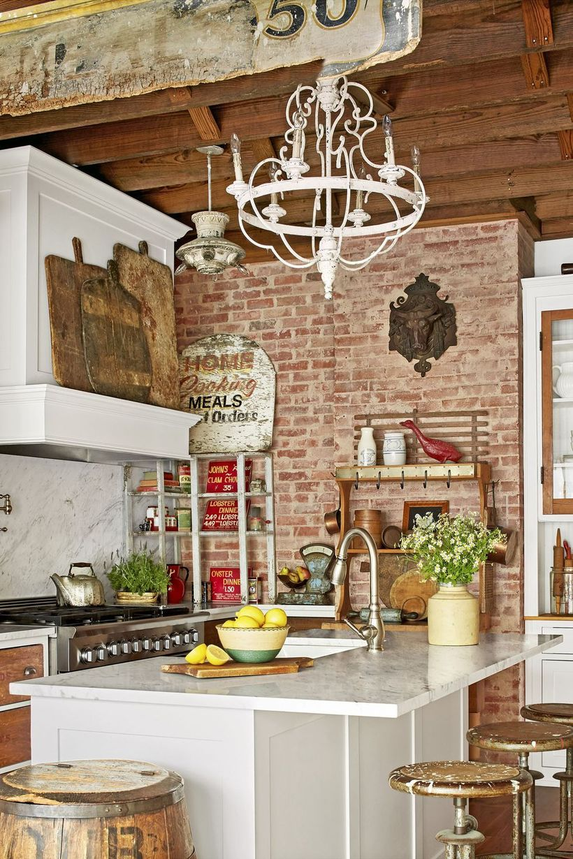 Farmhouse-style-storied-kitchen-with-wooden-rack-to-store-kitchen-utensils-and-classic-chandelier-for-your-kitchen
