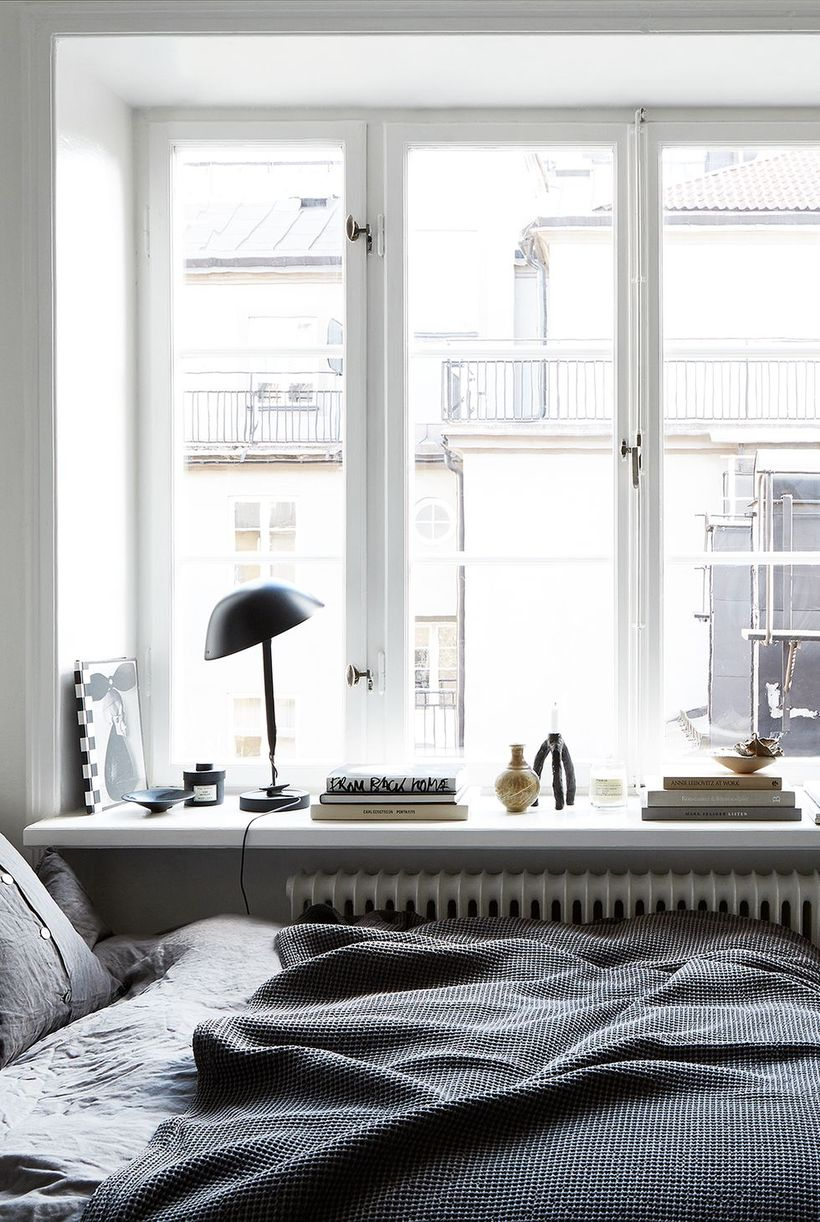 Gray-bedroom-and-minimalist-office-desk-that-becomes-one-with-your-bed-in-front-of-the-window-so-you-can-get-fresh-light-in-the-morning